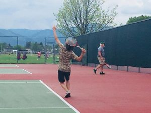 player gets ready to serve during social tennis at playfair